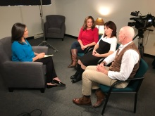 Cheryl, Nicky's Mom, and others being interviewed for a news story on Nicky's Law.